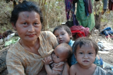 A Karen displaced family fleeing armed conflict in a temporary shelter on the bank of the Salween River, near a proposed dam site.